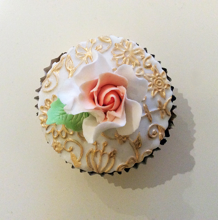 Vanilla and Chocolate Cupcakes with handmade sugar roses and stencilled fondant.